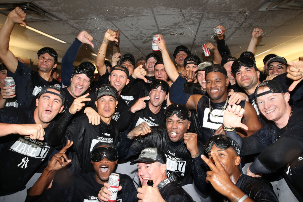 The Yankees toast themselves while celebrating their playoff clincher Saturday in Toronto (Getty Images).