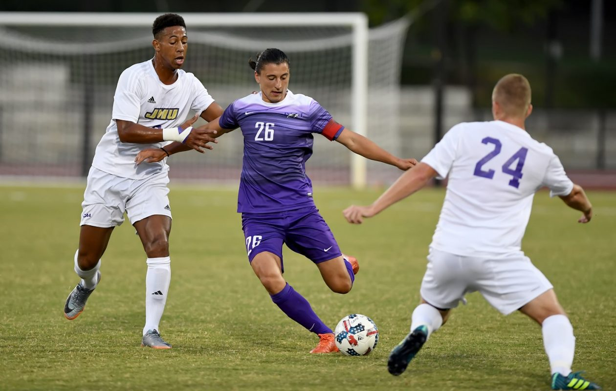 Niagara men's soccer redshirt senior Konrad Zydowicz, middle, wears the captain's armband. (via James Madison Athletics)