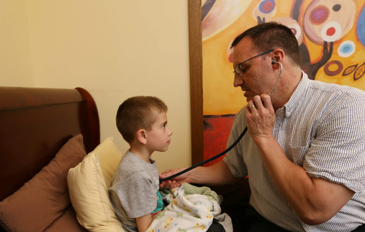 Dr. Ted Andrews examines Carter Faunce of Cheektowaga at Pediatric  & Adolescent Urgent Care of WNY in Amherst after Carter had an asthma attack last year. (Sharon Cantillon/Buffalo News file photo)
