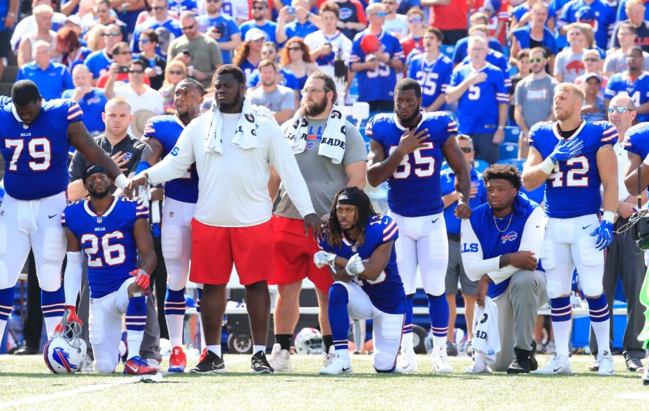 Several Buffalo Bills players, including Taiwan Jones (26) and Kaelin Clay (13) took a knee during the National Anthem before the start of the game against the Denver Broncos.  (Harry Scull Jr. / Buffalo News)