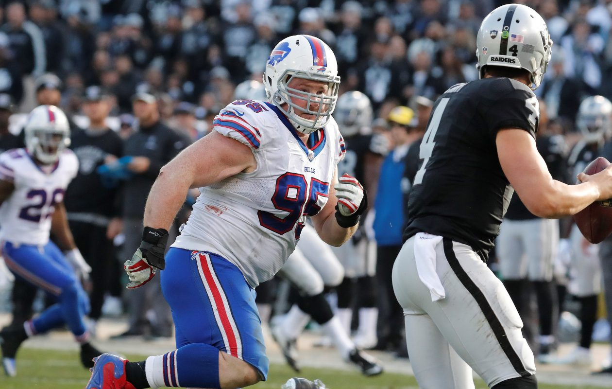 Buffalo Bills' Kyle Williams chases down Oakland Raiders quarterback Derek Carr. (Harry Scull Jr./Buffalo News)