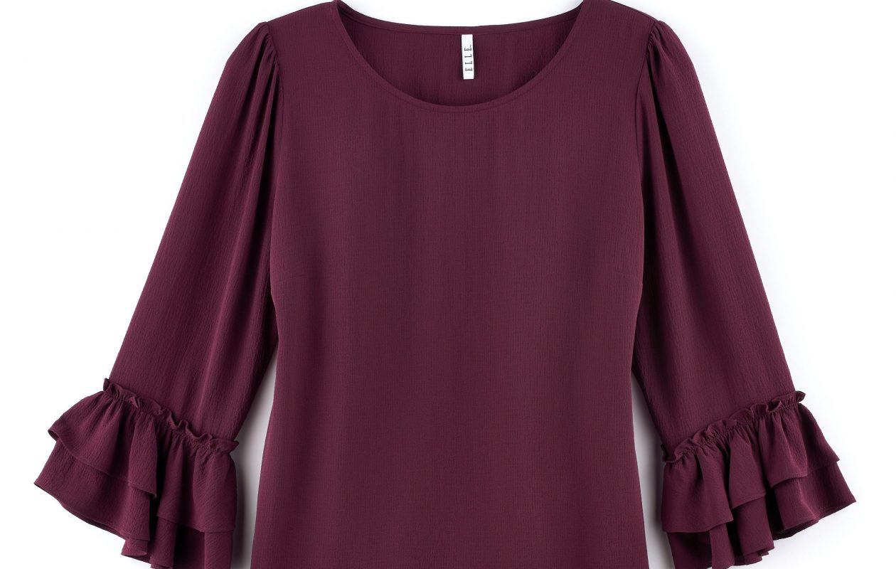 Wine colors, including burgundy, are a trendy way to update your black fall separates. This top from the Elle label, shown in Kohl's fall press kit, is just one of many options.