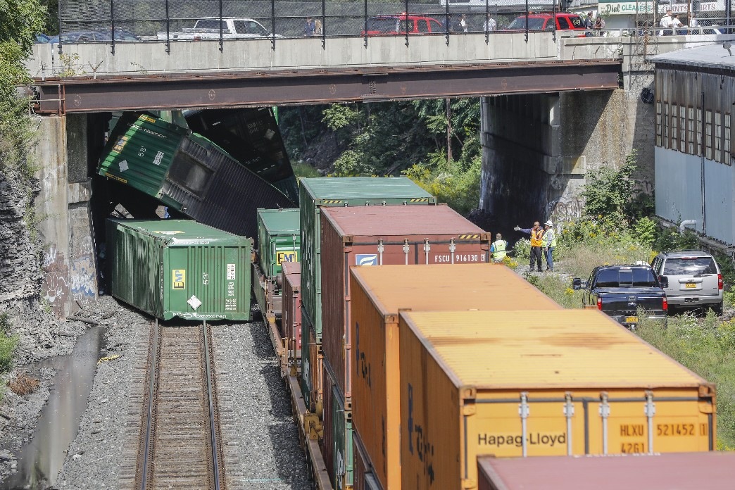 Container cars are toppled beneath the Main Street bridge as a train has derailed on the CSX line near Jewett Avenue, Wednesday, Sept. 13, 2017. (Derek Gee/Buffalo News)