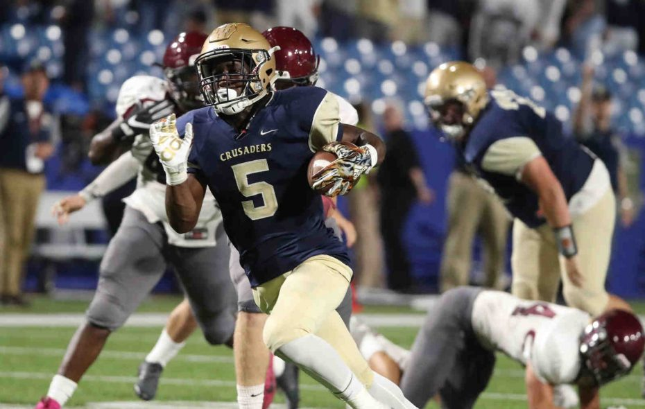 Joe Jamison runs for a 36-yard touchdown during Canisius' win over St. Joe's on Friday night. (James P. McCoy/Buffalo News)