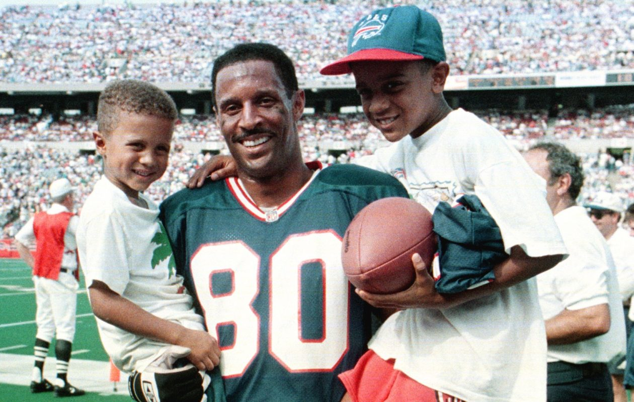 James Lofton is seen with his sons on Sept. 6, 1992, after setting the NFL record for career pass receiving yardage. (James P. McCoy/Buffalo News file photo)