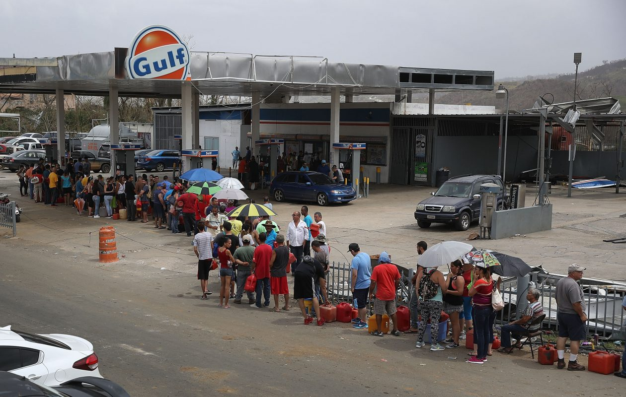 Puerto Ricans had to ait in long lines for fuel, water and food after last year's Hurricane Maria. (Getty Images)