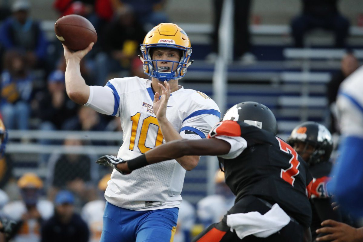 Matt Myers throws a pass to Juston Johnson that turned into West Seneca West's first touchdown of the game during a 35-13 win over McKinley. (Harry Scull Jr./Buffalo News)