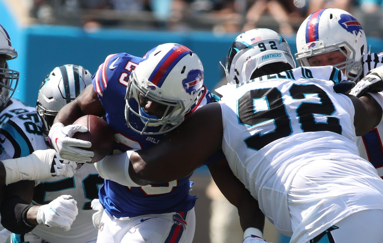 Buffalo Bills running back LeSean McCoy (25) is tackled for a loss by Carolina Panthers defensive tackle Vernon Butler (92) in the third quarter. (James P. McCoy/Buffalo News)