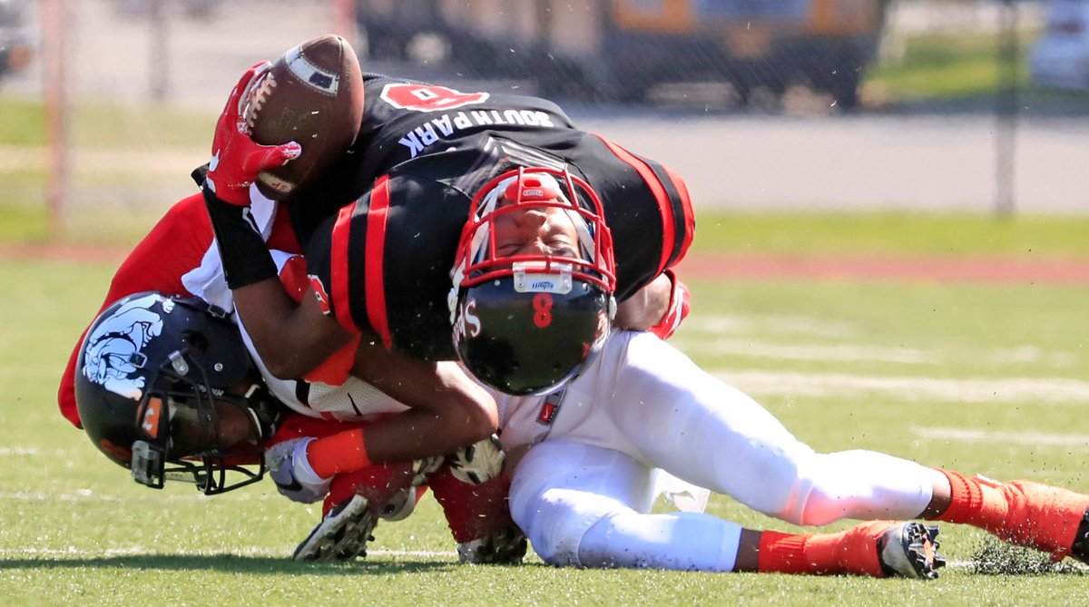 Dayquan Anderson absorbs a hard hit from a McKinley defender during South Park's 12-7 win Saturday at All High Stadium. (Harry Scull Jr./Buffalo News)