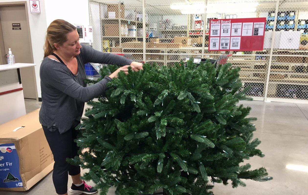 Brenda Hartman of Barker assembles a Christmas tree at BJ's in Amherst. (Robert Kirkham/ Buffalo News)