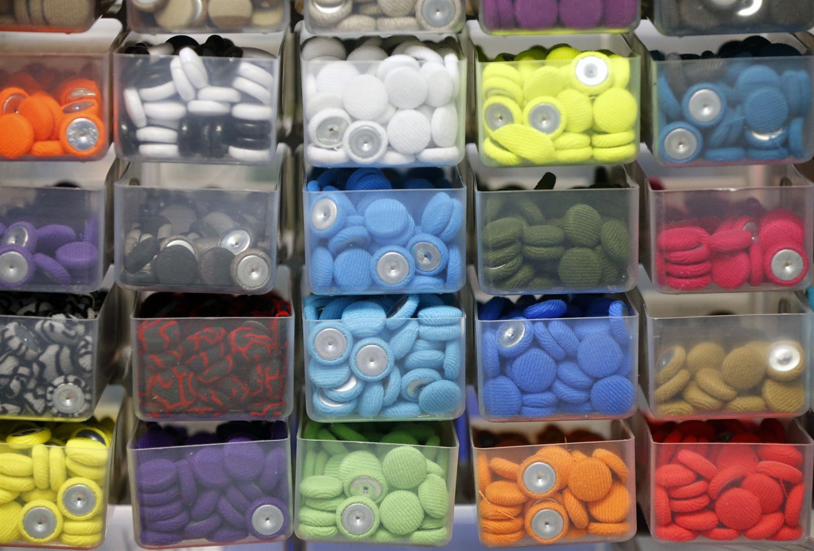 8076c4ac Some of the different colored buttons that will be used on the top of caps.  (Mark Mulville/Buffalo News)
