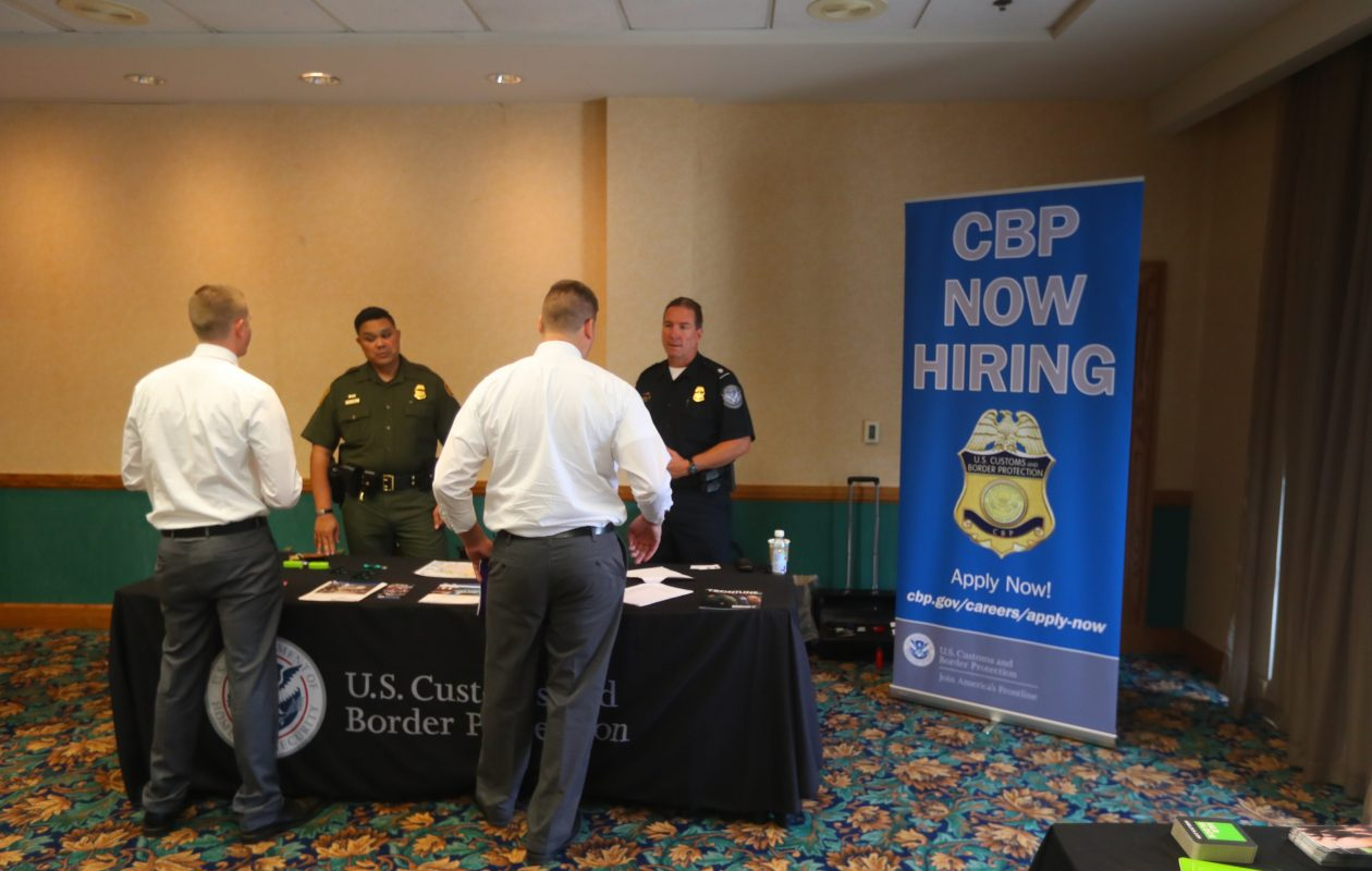Officers from U.S. Customs and Border Protection talk to candidates during a job fair. (John Hickey/News file photo)