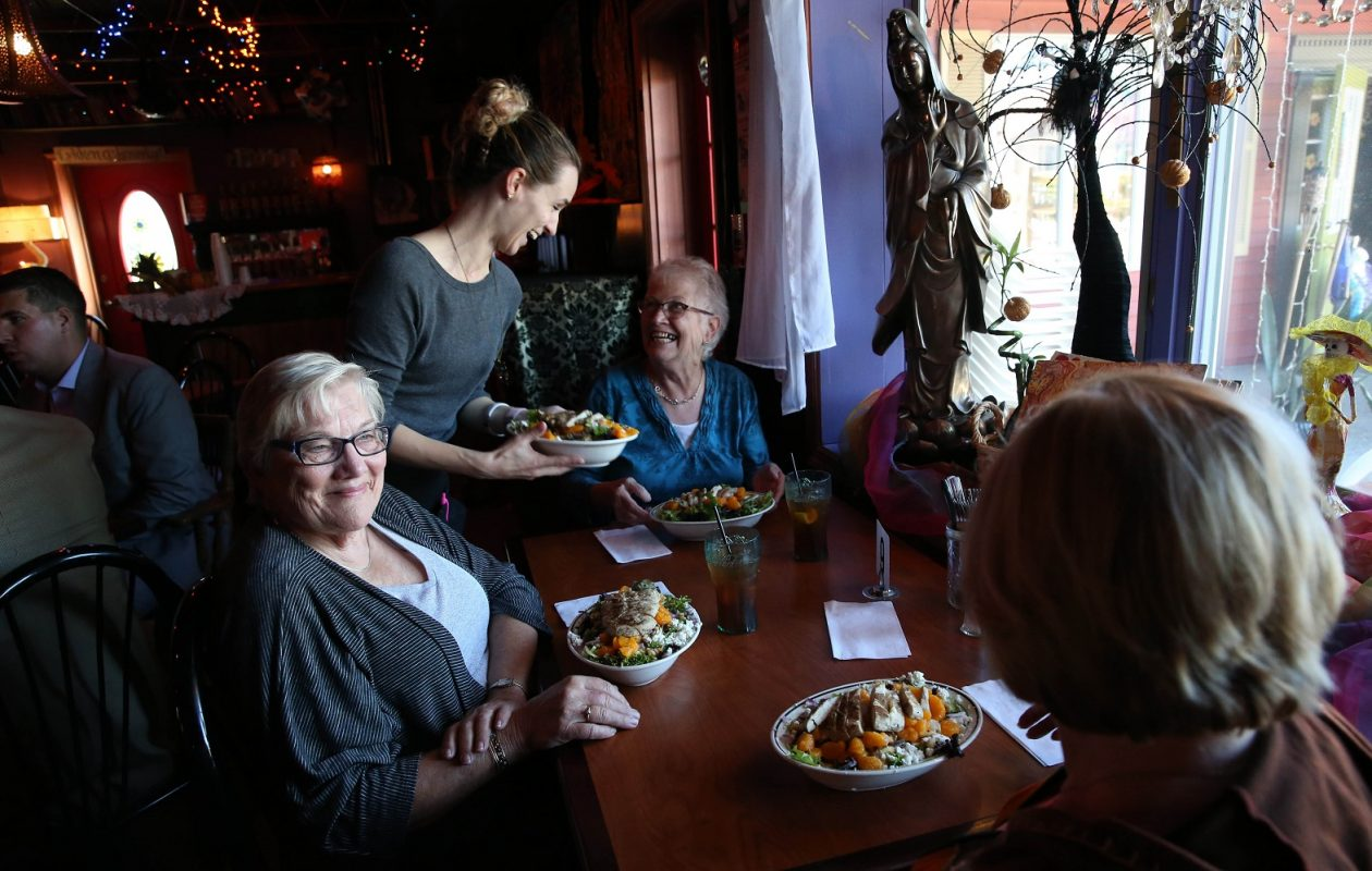 Penny Lane Cafe's Arlynn Knauff serves, from left, Evelyn Phillips of Alden, Dandy Empl  of Lancaster and Barb Ryan of Lancaster. (Sharon Cantillon/Buffalo News)