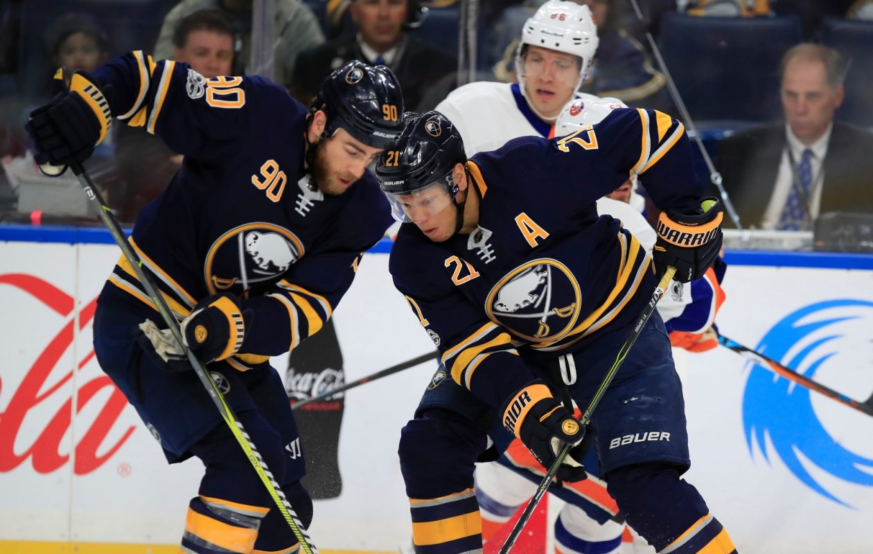 Ryan O'Reilly, left, and Kyle Okposo will be two of the four alternate captains this season. (Harry Scull Jr./Buffalo News)