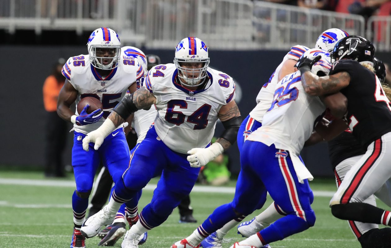 LeSean McCoy follows the block of Richie Incognito against the Falcons. (Harry Scull Jr./ Buffalo News)