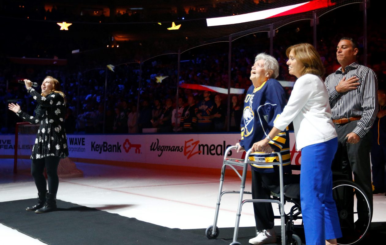Marian Morreale, 94, a World War II  Coast Guard veteran with an amputated leg, stands with her daughter Joan Brechtel  for the national anthem before the Sabres opener.  (Mark Mulville/Buffalo News)