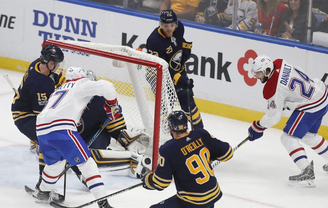 Jack Eichel (15), Ryan O'Reilly (90) and Sam Reinhart watch Montreal's Phillip Danault score short-handed in the opener. (Mark Mulville/Buffalo News)