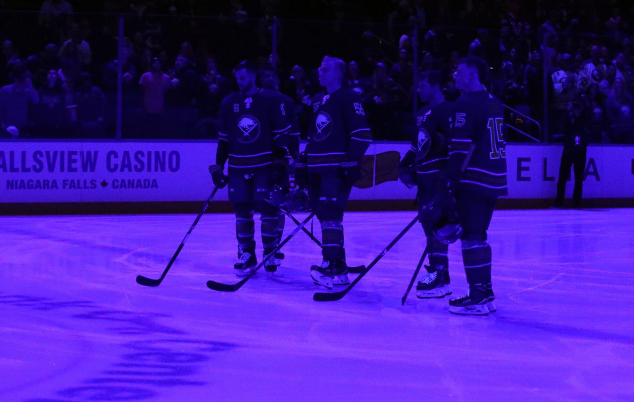 Buffalo Sabres holdd a moment of silence with blue ice for fallen Officer Craig Lehner at KeyBank Center on Oct. 20. (James P. McCoy/Buffalo News)