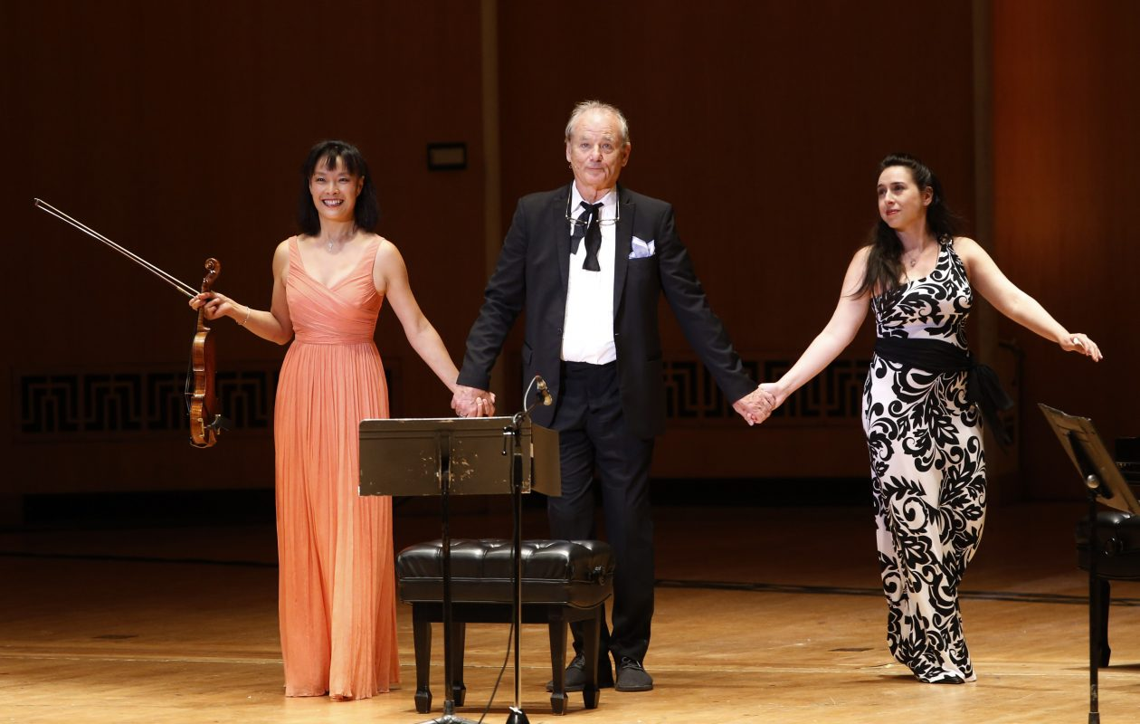 Bill Murray takes the stage at Kleinhans Wednesday night with violinist Mira Wang, left, and pianist Vanessa Perez for a night of readings, instrumentals and song. (Sharon Cantillon/Buffalo News)