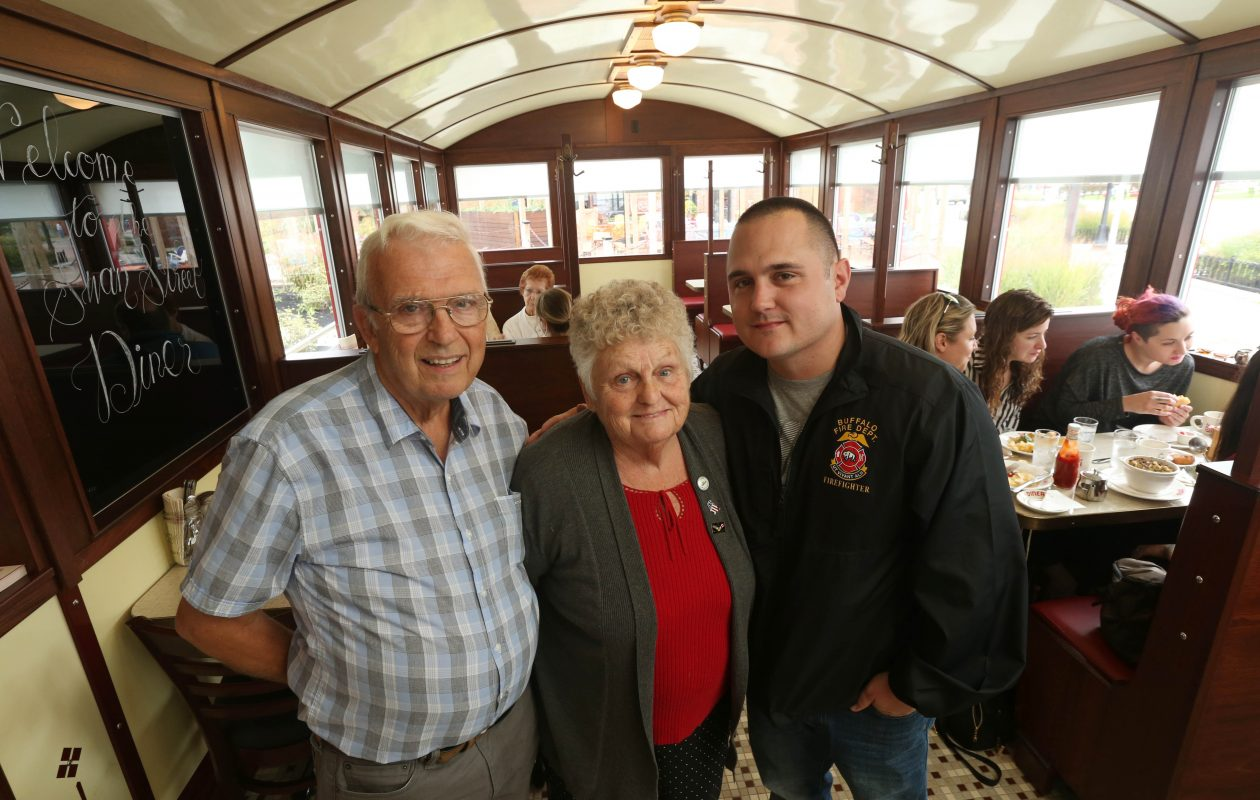 Jim and Betty McBride visited the Swan Street Diner Friday as it prepared to open in Larkinville. They ran the 1930s diner for 30 years in Newark, in Wayne County, before selling it for use in Buffalo a few years ago. Their grandson, Derek Rose, right, now a Buffalo firefighter, grew up in Newark. He has fond memories of eating there and was even a dishwasher in his teens. (Sharon Cantillon/Buffalo News)