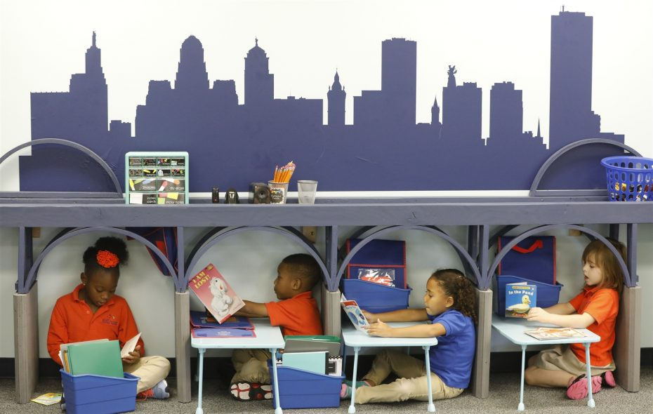 """First graders in the Buffalo room read at individual reading stations beneath the """"Peace Bridge"""" at the REACH Academy Charter School. (Derek Gee/Buffalo News)"""