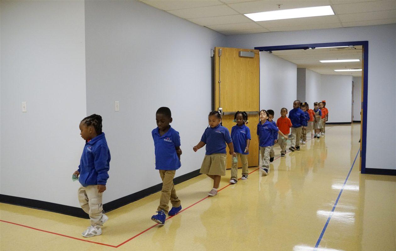 A kindergarten class walks through the hallway at REACH Academy Charter School. (Derek Gee/Buffalo News)