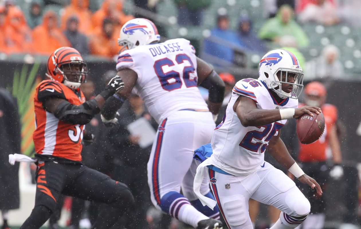 Buffalo Bills running back LeSean McCoy (25) rushes for a first down over Cincinnati Bengals free safety Derron Smith (31) in the third quarter at Paul Brown Stadium in Cincinnati in Ohio on Sunday, Oct. 8, 2017.  (James P. McCoy / Buffalo News)