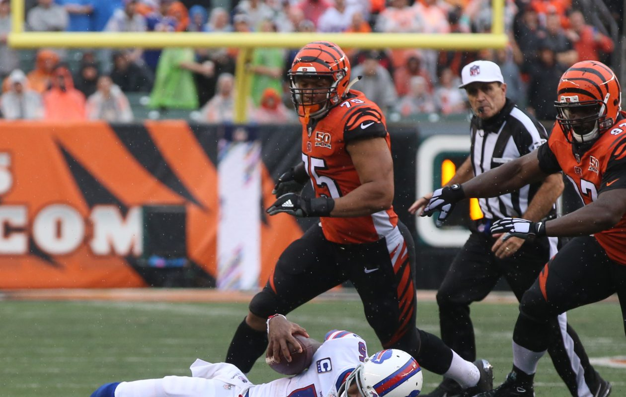 Buffalo Bills quarterback Tyrod Taylor (5) trips and falls in front of Cincinnati Bengals outside linebacker Vontaze Burfict (55) in the fourth quarter at Paul Brown Stadium in Cincinnati in Ohio on Sunday, Oct. 8, 2017.  (James P. McCoy/Buffalo News)