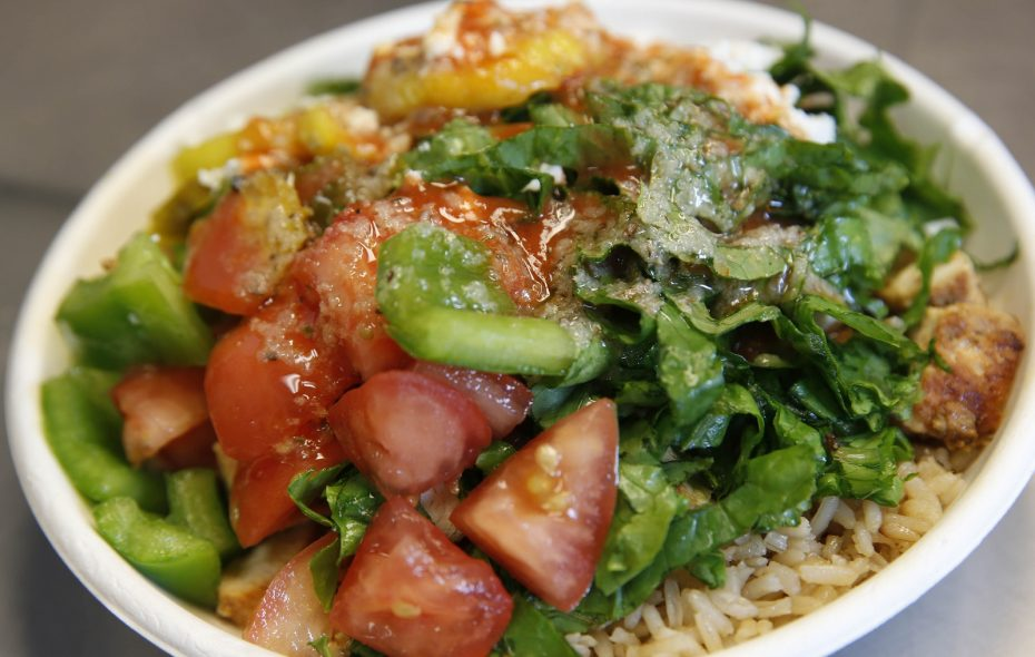 The chicken rice bowl from Rachel's Mediterranean is topped with vegetables. (Sharon Cantillon/Buffalo News)