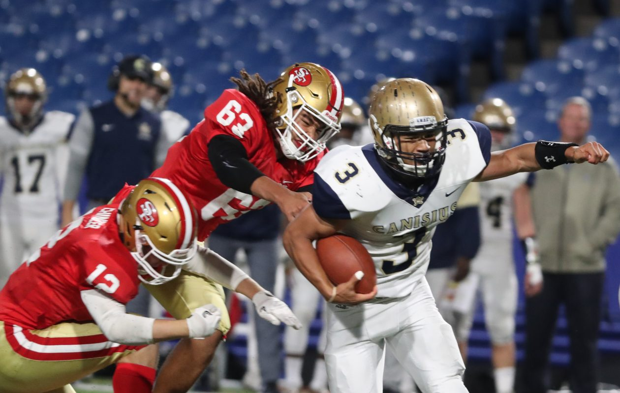 Canisius' Joel Nicholas is off to the races for one of his three touchdowns during Thursday's game against St. Francis at New Era Field.  (James P. McCoy/Buffalo News)