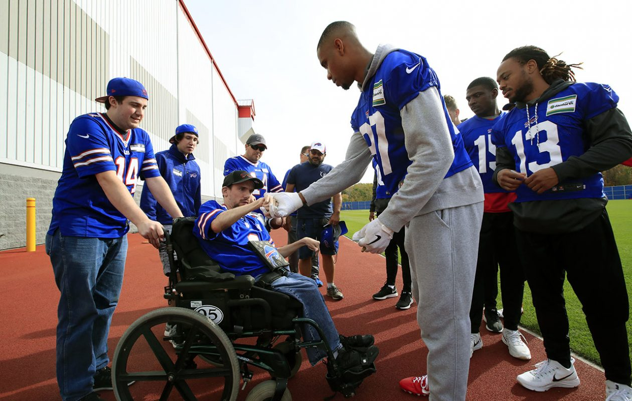 Buffalo Bills fan Josh Pretko shakes hands with wide receiver Jordan Matthews after getting to visit practice Oct. 21. (Harry Scull Jr./ Buffalo News)