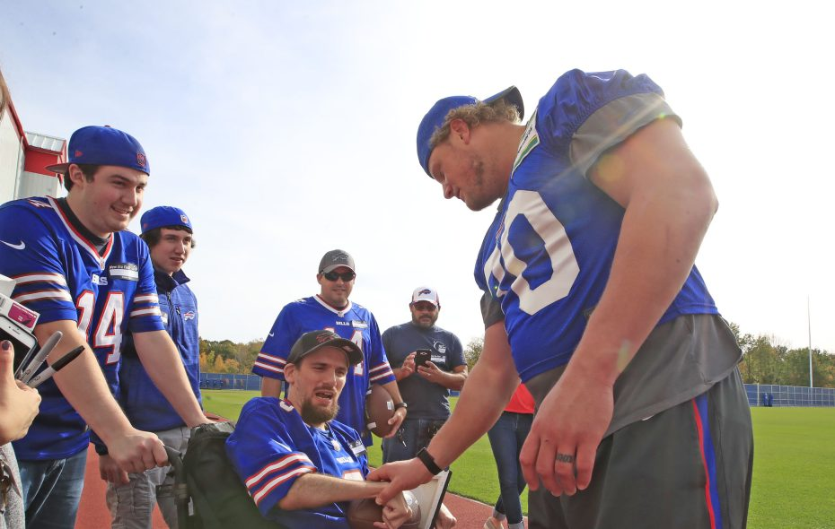 Buffalo Bills fan Jos Pretko meets Eric Wood after a walk thru practice at New Era Field on Saturday, Oct. 21, 2017. (Harry Scull Jr./ Buffalo News)