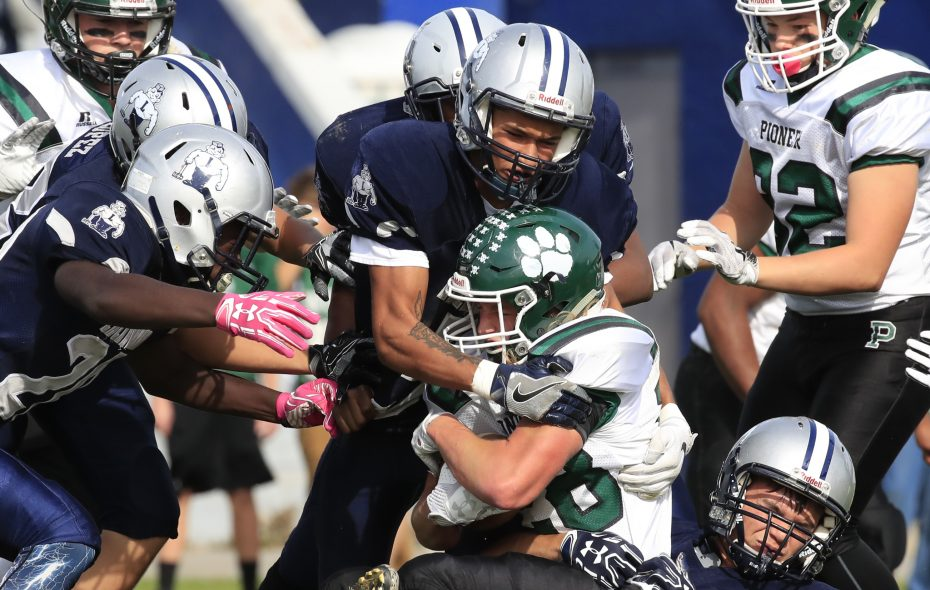 Lackawanna defenders tackle Pioneer running back Wake Kless during Saturday afternoon's Section VI Class B quarterfinal at Veterans Stadium in Lackawanna. (Harry Scull Jr./ Buffalo News)