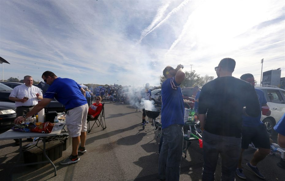 Bills fans tailgate – more safely than at least one of their peers – outside New Era Field on Oct. 22. (Mark Mulville/Buffalo News)