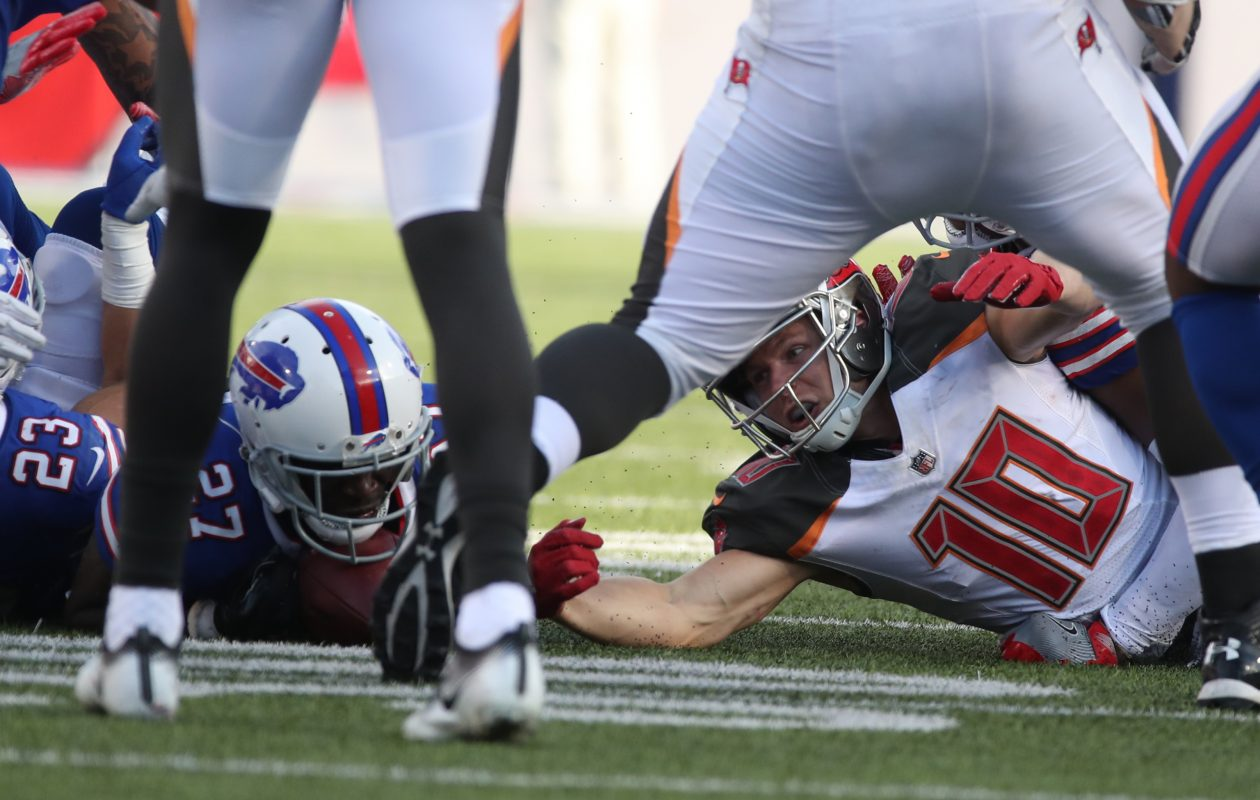 Buffalo Bills cornerback Tre'Davious White (27) recovers a fumble by Tampa Bay Buccaneers wide receiver Adam Humphries (10) in the fourth quarter. (James P. McCoy/Buffalo News)