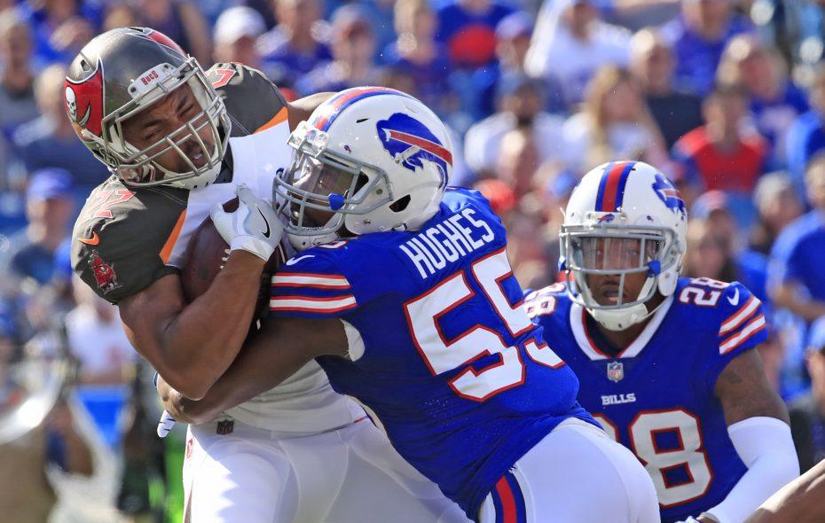 Buffalo Bills defensive end Jerry Hughes tackles Tampa Bay Buccaneers running back Doug Martin. (Harry Scull Jr./Buffalo News)