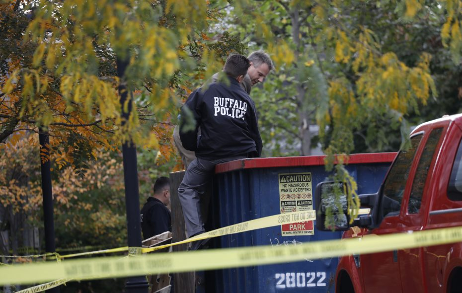 Buffalo Police investigate remains found in a dumpster behind a Canisius High School building undergoing renovations on West Ferry Street and Delaware Avenue, Tuesday, Oct. 24, 2017.  The remains turned out to be that of a bear.  (Derek Gee/Buffalo News)