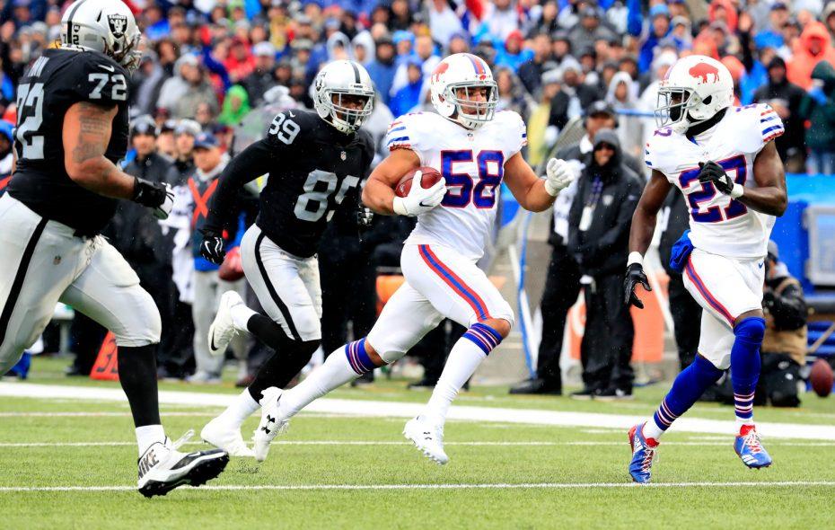 Bills linebacker Matt Milano returns a fumble for an interception Sunday against the Oakland Raiders. (Harry Scull Jr./Buffalo News)