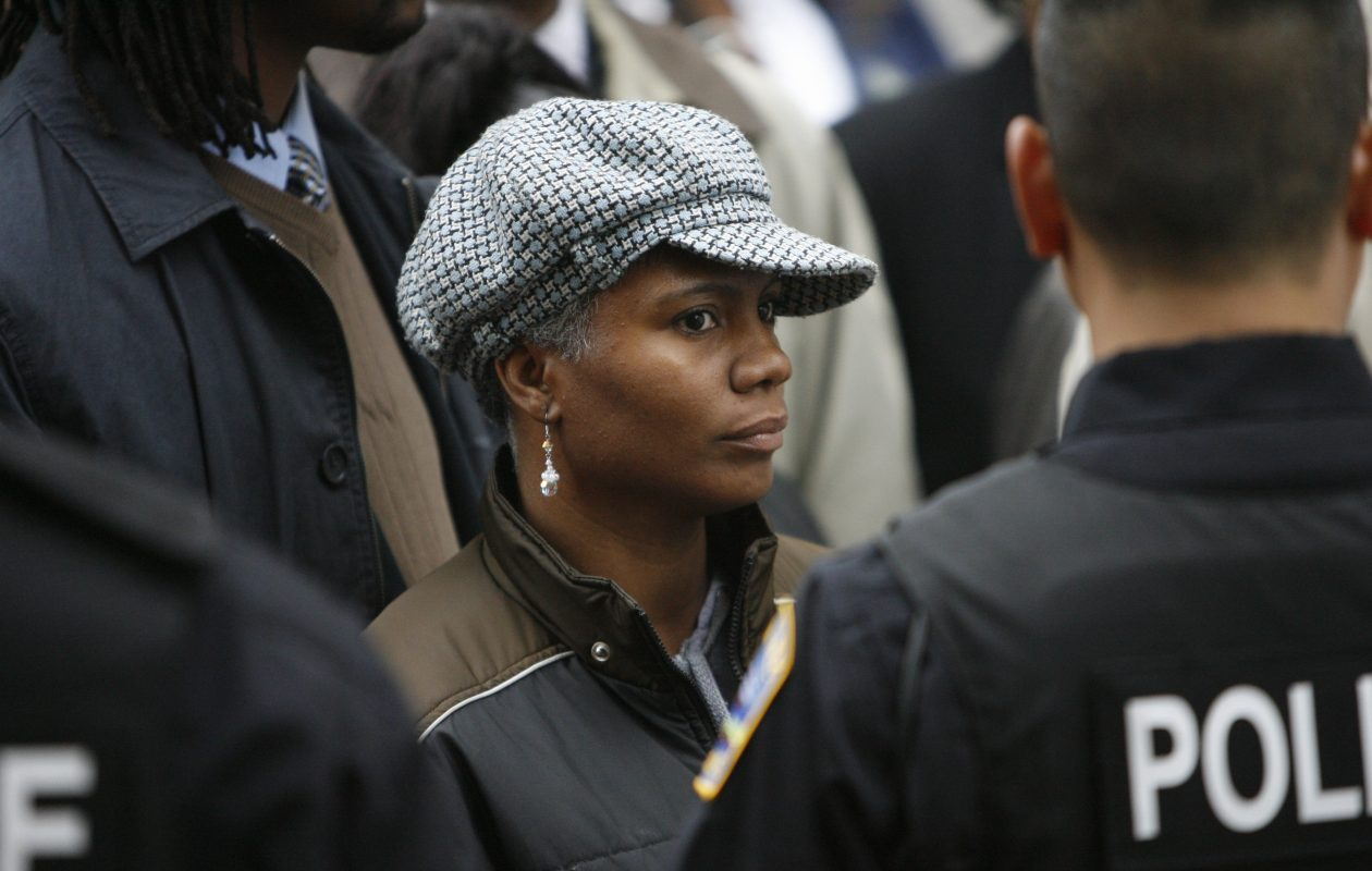 Fired Buffalo Police officer Cariole Horne looks on as supporters argue their right to protest with police who prevented the group from continuing further down Franklin Street where a police memorial was taking place at  St. Joseph's Cathedral in  2008. (News file photo)