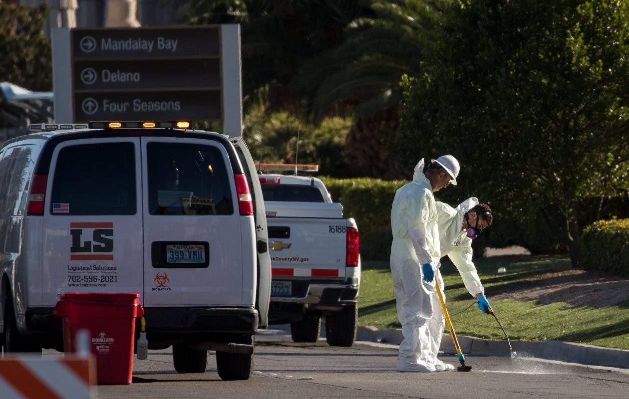 Hazardous material clean-up workers scrub the street on Las Vegas Blvd. outside the Route 91 Harvest Festival grounds Monday in Las Vegas where a gunman killed 59 people and wounded more than 500 late Sunday. Law enforcement authorities hope the gunman's girlfriend will shed light on his motive for the attack.  (Photo by Drew Angerer/Getty Images)