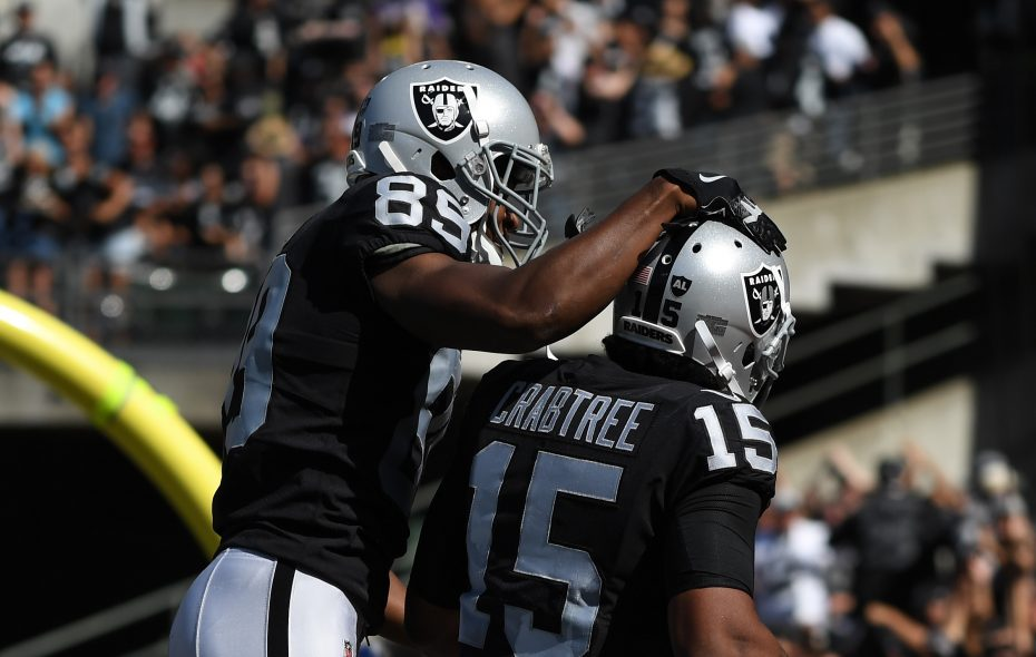 Michael Crabtree of the Oakland Raiders celebrates with Amari Cooper after a 41-yard touchdown against the Baltimore Ravens. (Getty Images)