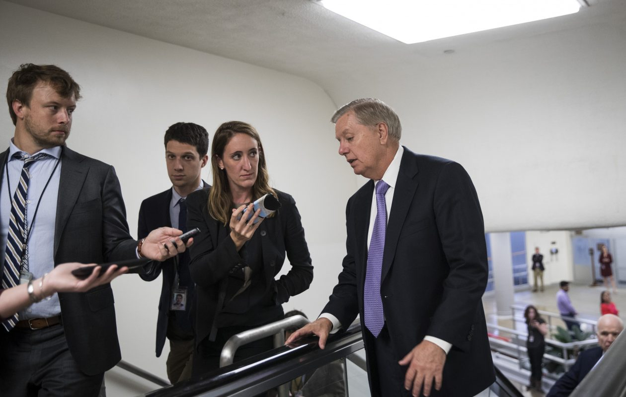 Sen. Lindsey Graham (R-SC) talks to reporters as he heads to a vote on amendments to the fiscal year 2018 budget resolution, on Capitol Hill, October 19, 2017 in Washington, DC. Thursday afternoon, the Senate kicked off a 'vote-a-rama;' a marathon voting session for amendments to the budget resolution. (Photo by Drew Angerer/Getty Images)