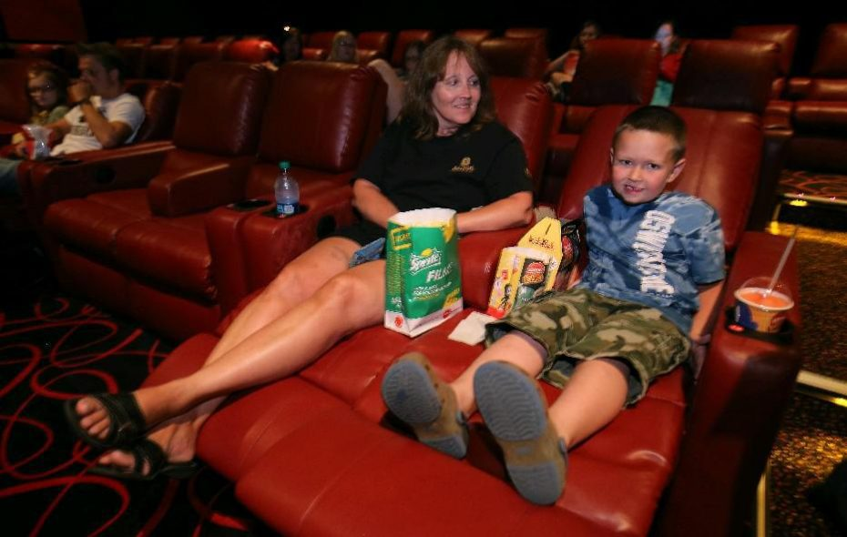 File photo shows moviegoers enjoying the reclining seats at the AMC Maple Ridge 8 movie theater in Amherst. The theater was sold recently to a real estate investment trust for $18.1 million.(News file photo)