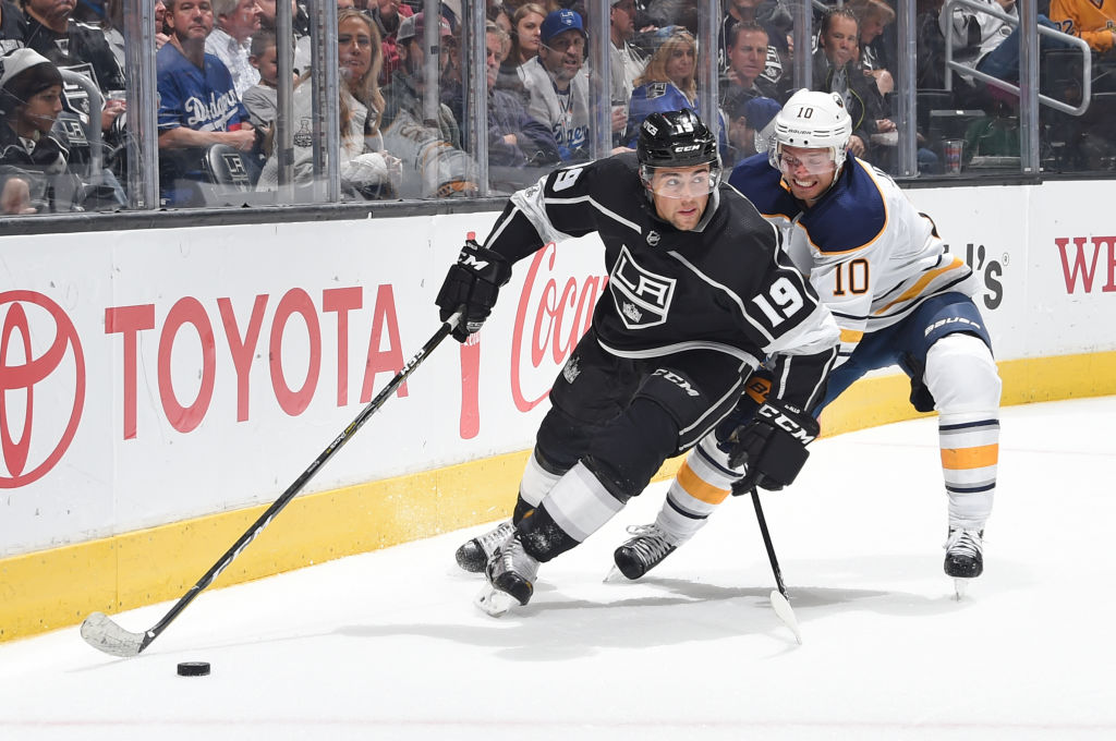 Eden native Alex Iafallo of the Los Angeles Kings works the puck against Jacob Josefson of the Sabres during the second period Saturday (Getty Images).