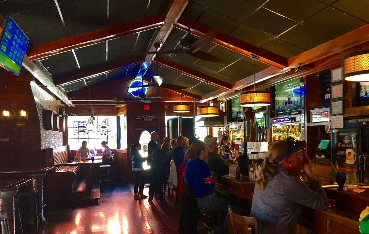 Bills fans line up at the Ice House Pub's authentic wooden bar. (Elizabeth Carey/Special to The News.)