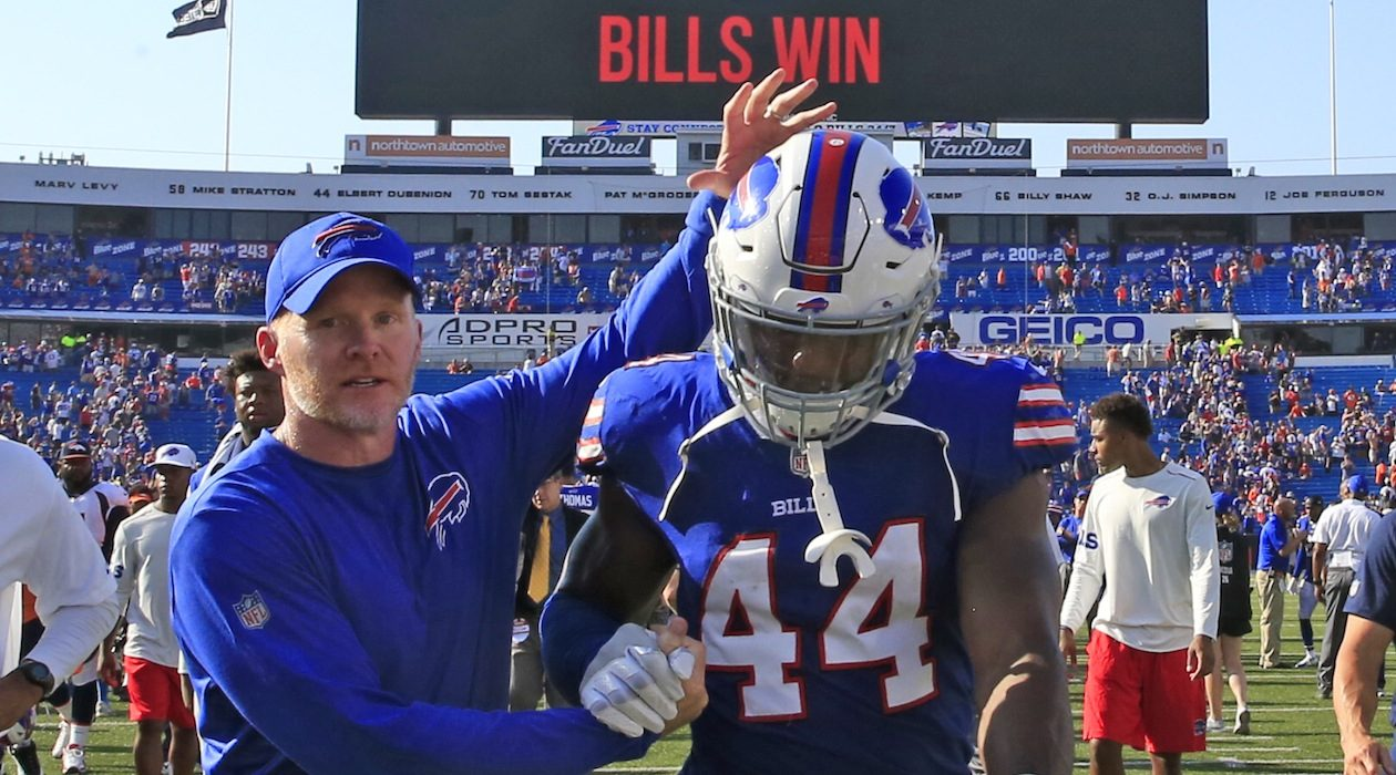 Deon Lacey gets congratulated by Sean McDermott after the win over Denver last season. (Harry Scull Jr./Buffalo News)
