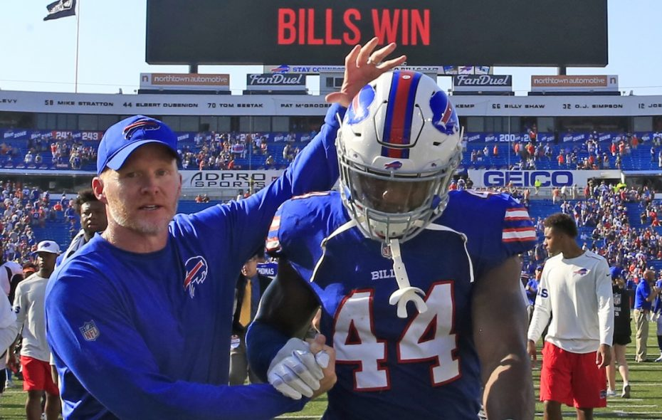 Deon Lacey gets congratulated by Sean McDermott after a win over Denver in 2017. (Harry Scull Jr./News file photo)