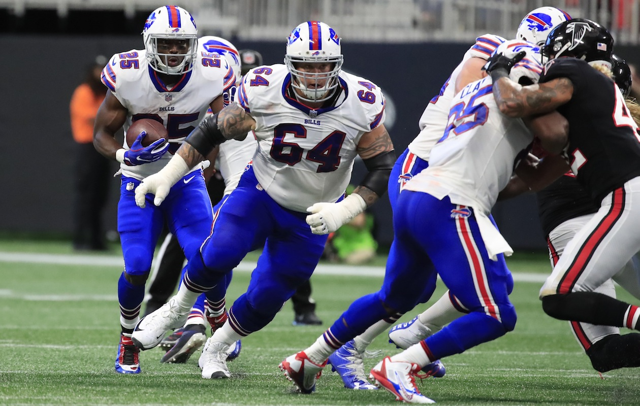 Bills guard Richie Incognito leads the way for LeSean McCoy. (Harry Scull Jr./Buffalo News)
