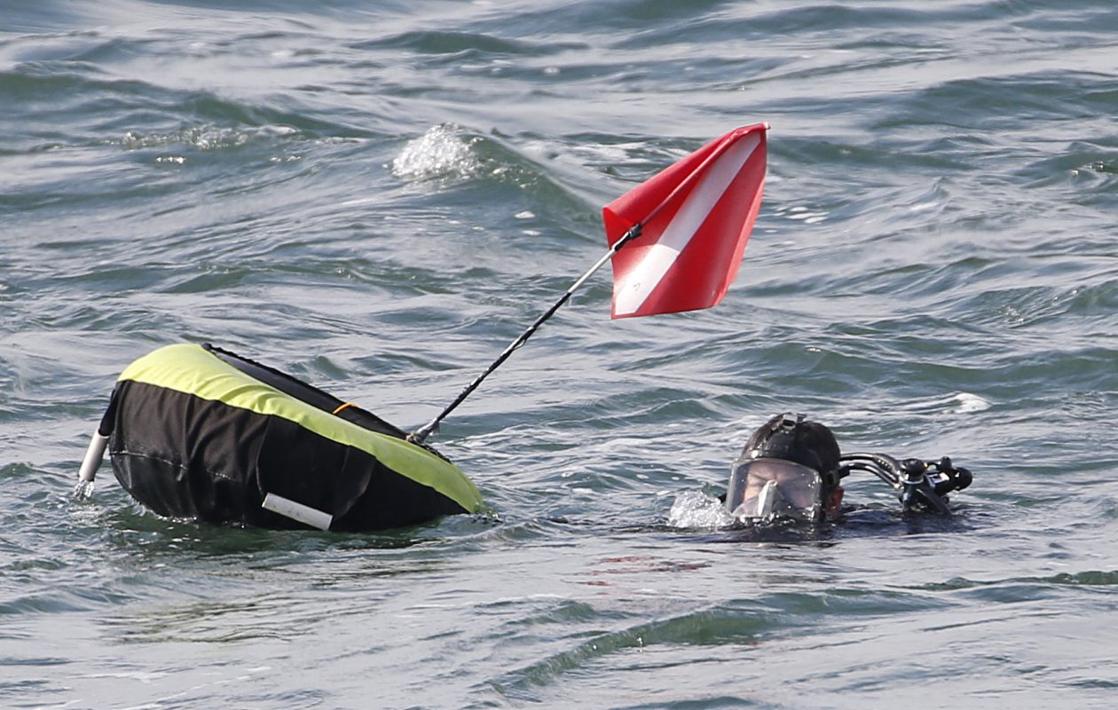 A police diver resumes the search for Buffalo Police Officer Craig Lehner who disappeared during  training exercises yesterday in the Niagara River. Photo taken   Saturday, Oct. 14, 2017.   (Sharon Cantillon/Buffalo News)