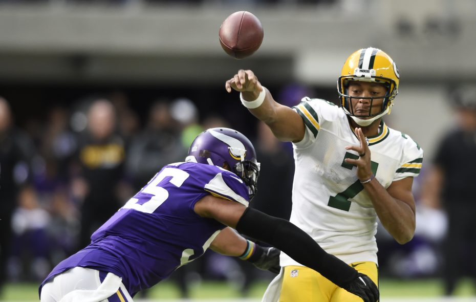Brett Hundley of the Green Bay Packers throws the ball before being hit by Anthony Barr of the Minnesota Vikings during the second quarter of the game on October 15, 2017, at US Bank Stadium in Minneapolis. (Getty Images)